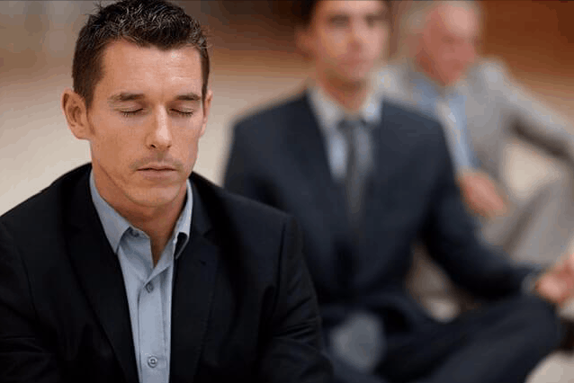 executive meditating in a corporate meditation program